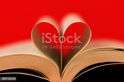 503130452istockphoto Romantic heart-shaped page book/Red background 820732242