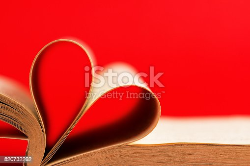 503130452istockphoto Romantic heart-shaped page book/Red background 820732262