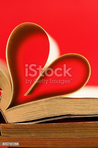 503130452istockphoto Romantic heart-shaped page book/Red background 820732288