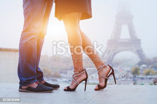 romantic holidays in Paris, feet of couple kissing near Eiffel tower