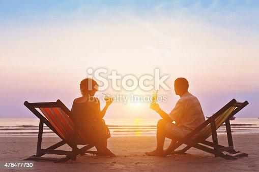family enjoying romantic sunset on the beach