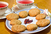Lovely and romantic tea breakfast with homemade vegan biscuit and flower tea