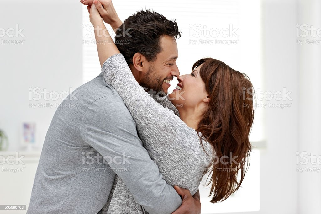 Romantic interracial couple embracing each other stock photo