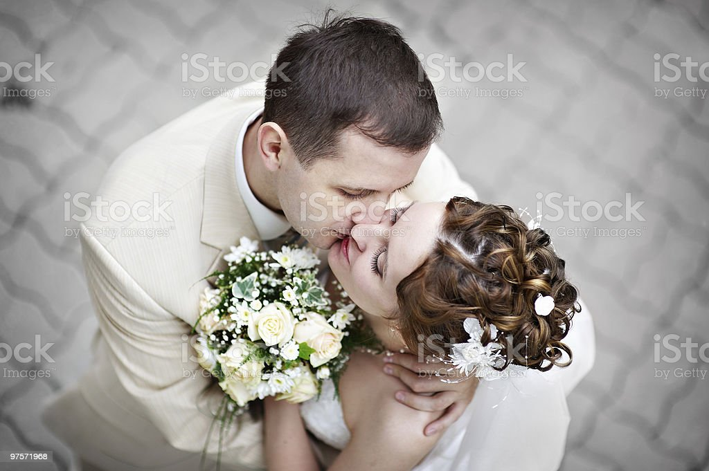 Romantic kiss the bride and groom royalty-free stock photo