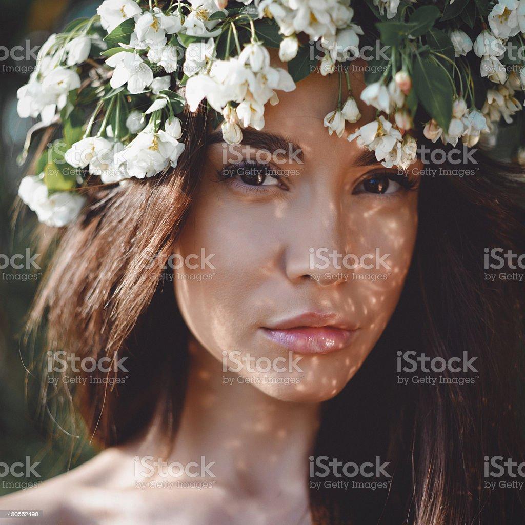 Romantic lady in wreath of apple trees stock photo