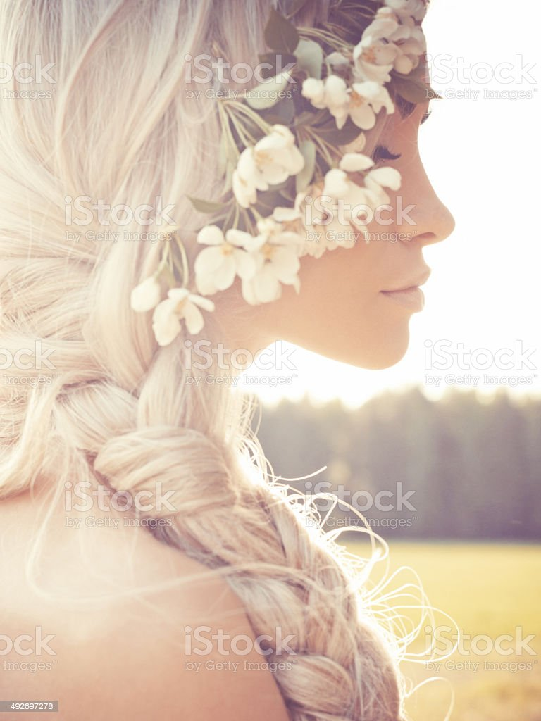 Romantic lady in wreath of apple trees stock photo