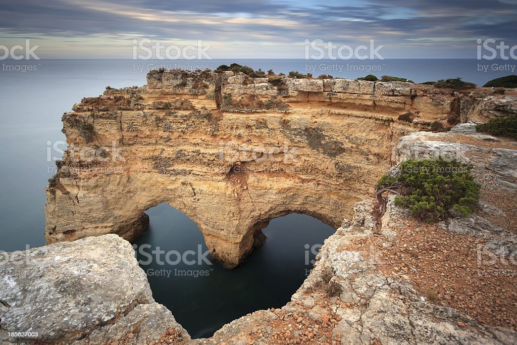 Romantic landscape with a stone heart formed by rocks. stock photo