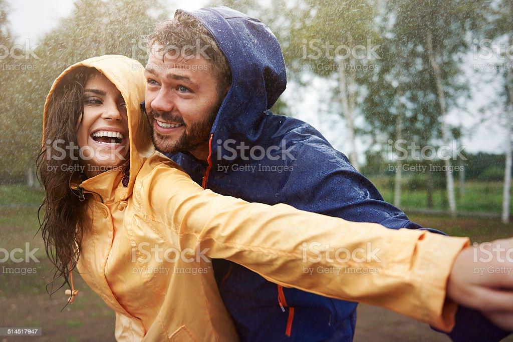 Romantic love in the pouring rain stock photo