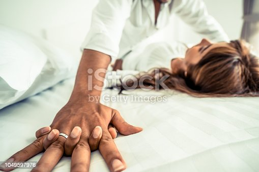 istock Romantic love of young couple in the bedroom. 1049597976