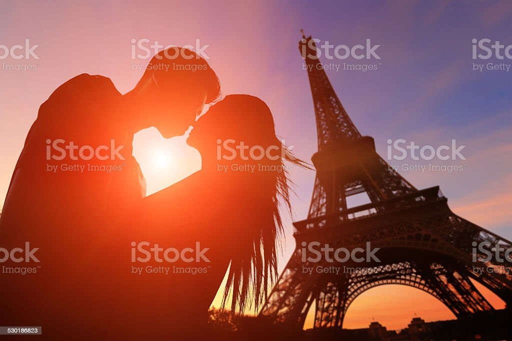 Romantic lovers with eiffel tower stock photo