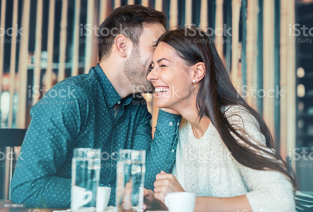 Romantic loving couple having a date in a cafe stock photo