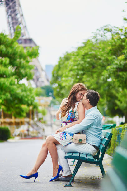 Romantic loving couple having a date near the Eiffel tower - Photo