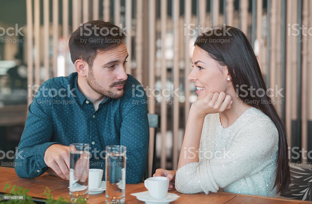 Romantic loving couple on a date in the cafe stock photo