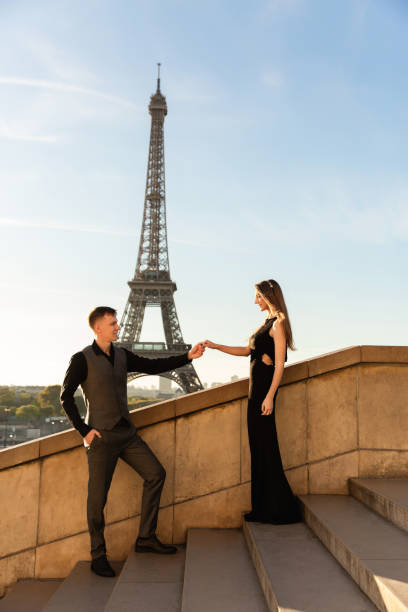 Romantic marriage proposal in Paris near the Eiffel tower. Honeymoon, date in France. Couple in love stock photo