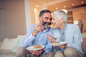 istock Romantic mature couple enjoying in their home 1046052898
