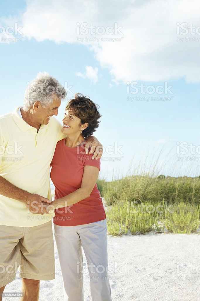 Romantic mature couple enjoying their vacation on a beach royalty-free stock photo