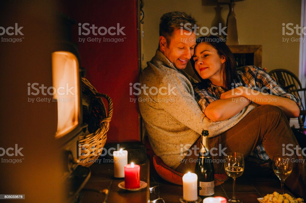 Romantic Mature Couple Relaxing at Home stock photo