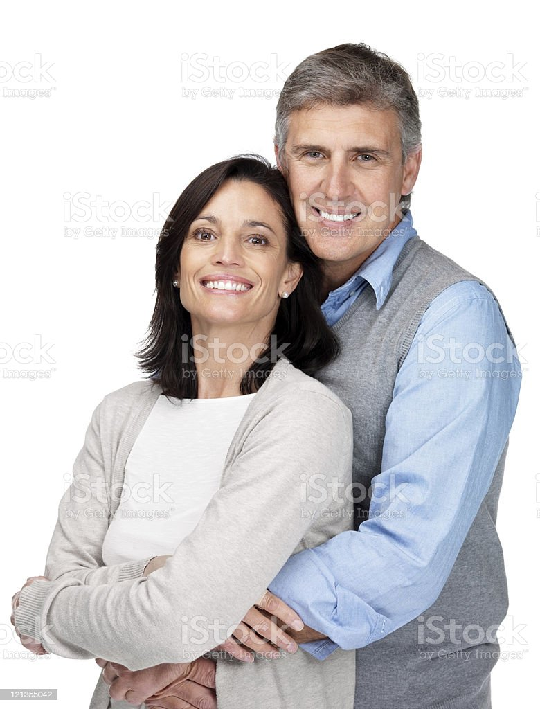 Romantic mature couple standing together against white royalty-free stock photo