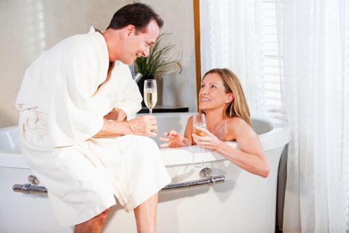 610769340 istock photo Romantic mature couple with champagne in bathtub 481107817