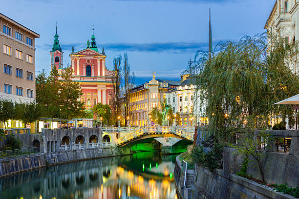 Romantic medieval Ljubljana, Slovenia, Europe. Romantic medieval Ljubljana's city center, capital of Slovenia, Europe. Night life on the banks of river Ljubljanica where many bars and restaurants take place. Franciscan Church in background ljubljana stock pictures, royalty-free photos & images
