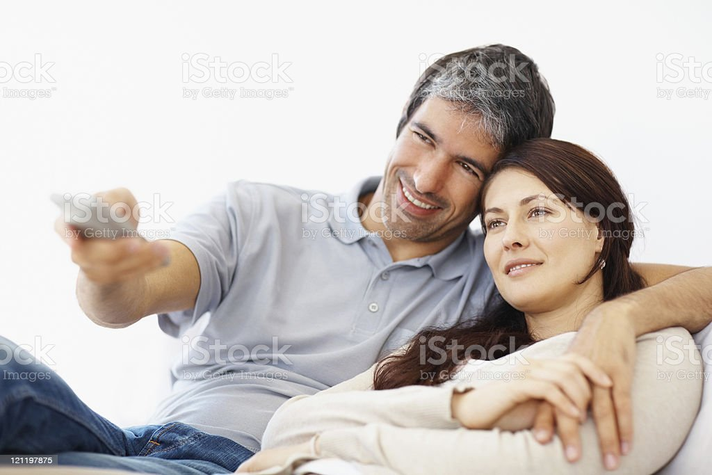 Romantic mid adult couple watching television royalty-free stock photo