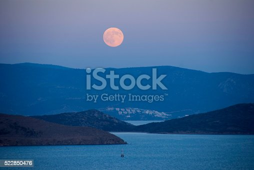istock romantic moonlit night over the sea 522850476