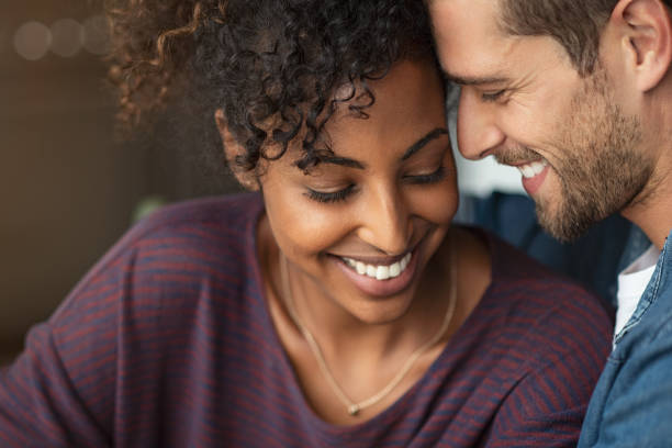 romantic multiethnic couple in love - flirtare foto e immagini stock