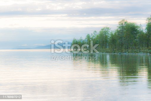 Romantic, mysterious lake view very early in the morning. Photo was made near the Norwegian - Swedish border: Lake Femunden