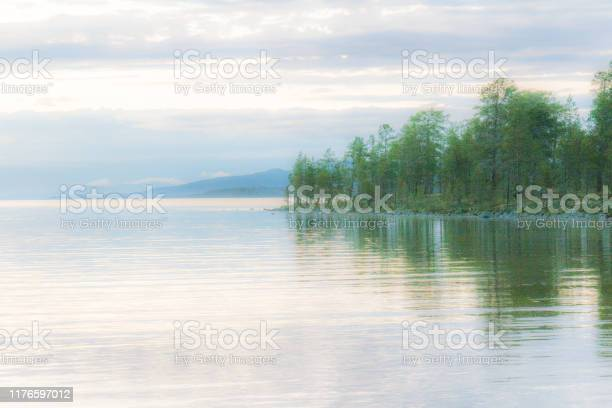 Photo of Romantic, mysterious lake view very early in the morning
