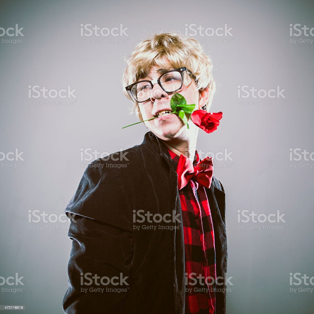 Romantic Nerd Man with Single Rose in Mouth Valentines Day stock photo