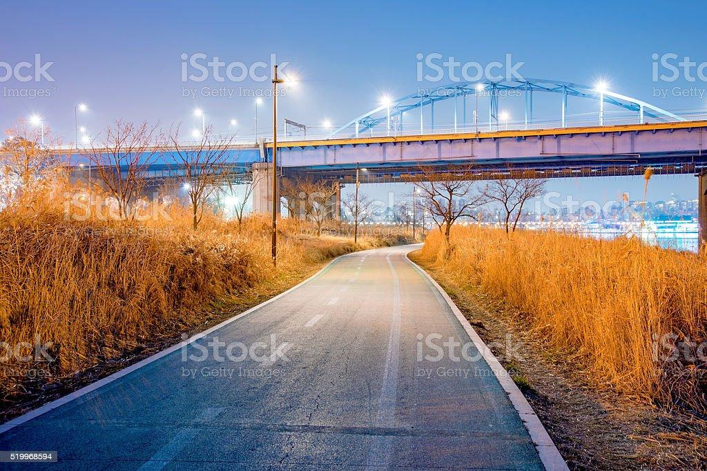 Romantic night scene of cycling path near the han river stock photo
