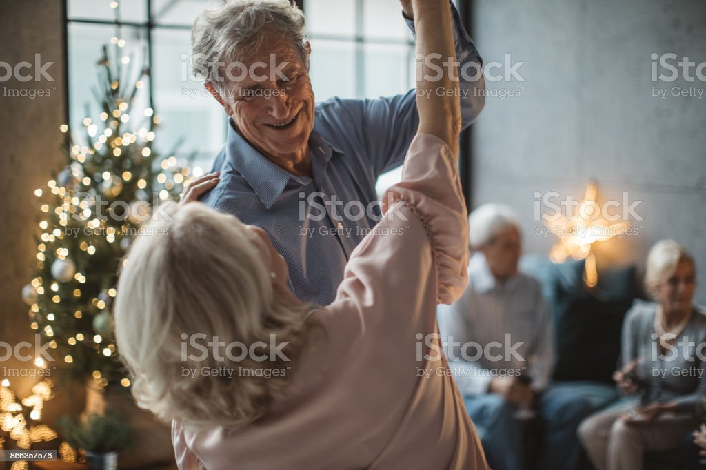 Senior people celebrate Christmas, they are on party drinking some...