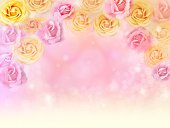 istock romantic pink and yellow roses flower border with bokeh 506478284