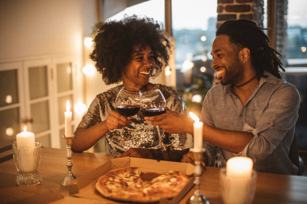 romantic pizza evening at home - date night stock pictures, royalty-free photos & images