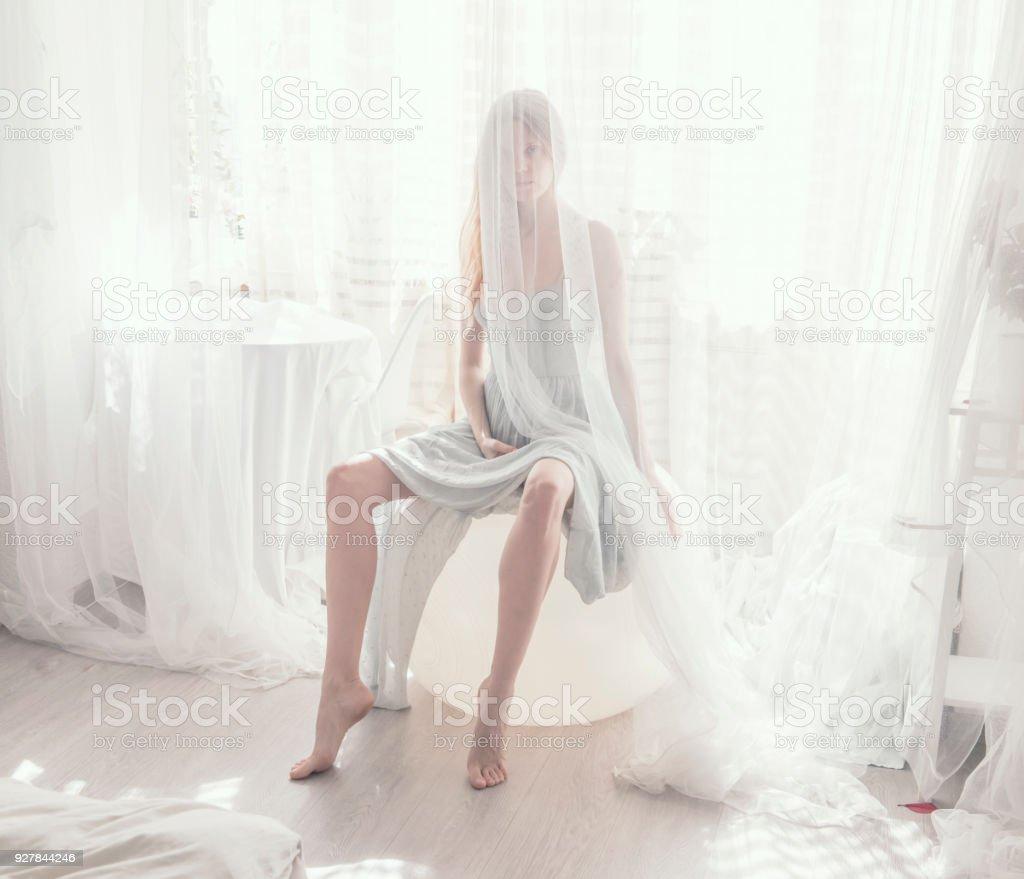romantic portrait of young women in light tones stock photo