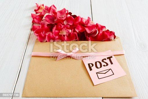 680461500 istock photo Romantic post message with flower petals, closeup 593297736
