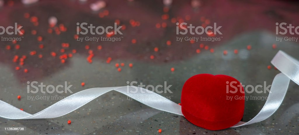 Romantic presents in honor of Valentine`s day, red heart and case