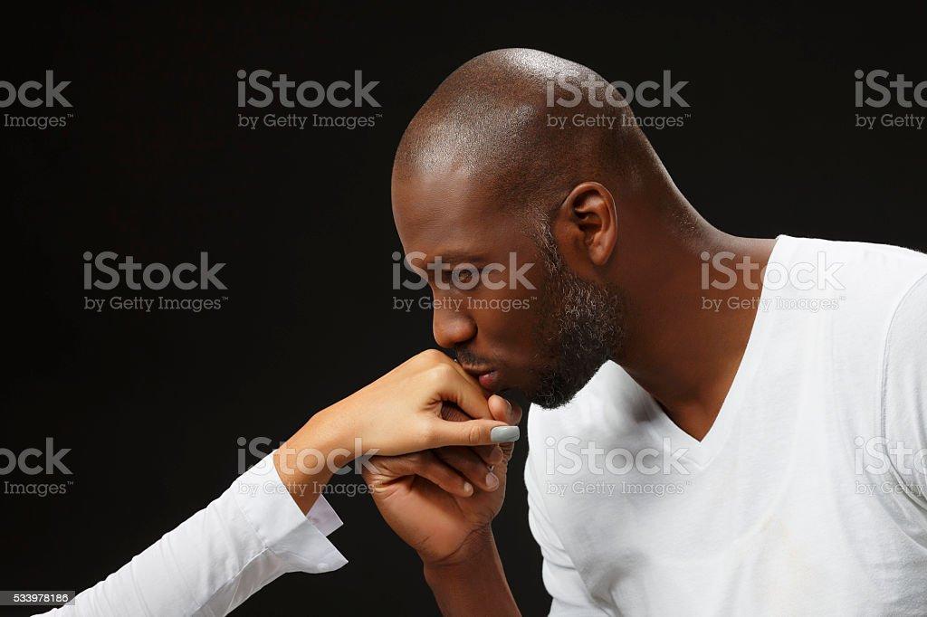 Romantic proposing  Kneeling man gentlelman kissing woman's hand stock photo