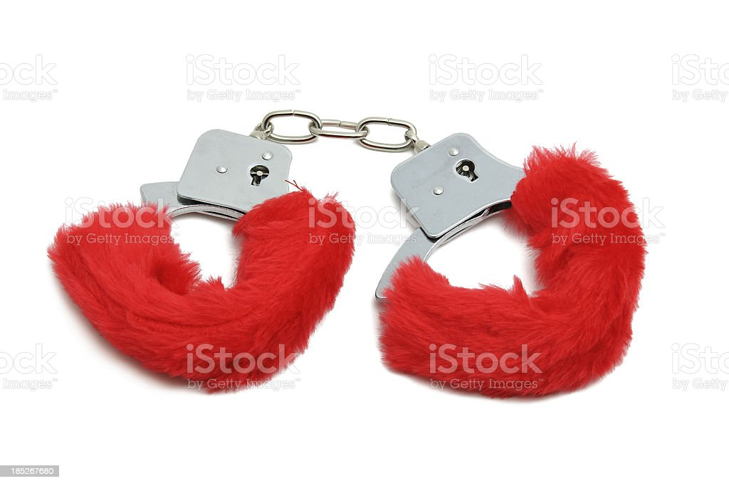 Romantic red handcuffs stock photo