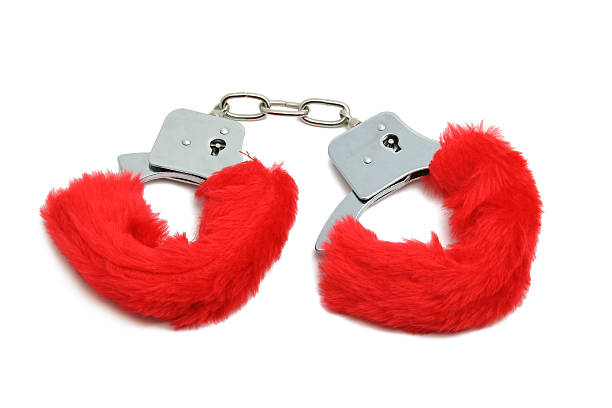 romantic red handcuffs - fluffy stock photos and pictures