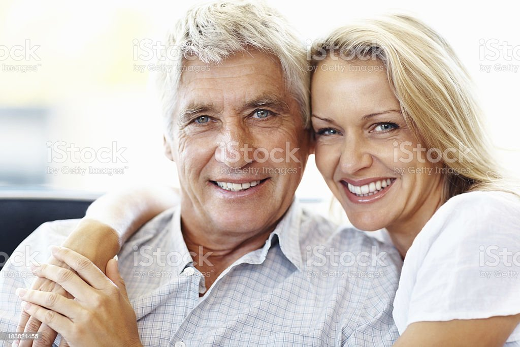 Romantic, retired couple smiling together royalty-free stock photo