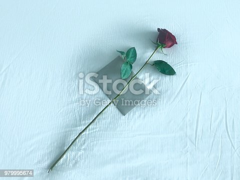 istock Romantic Rose and Card on Bed 979995674