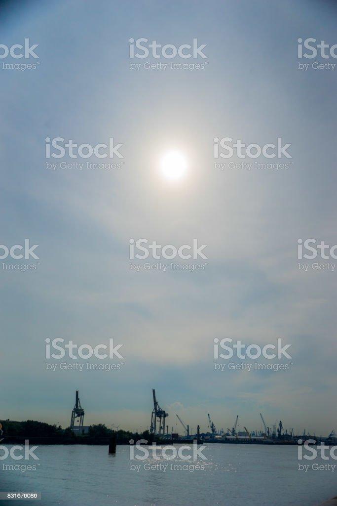 Romantic scenery of cranes at the docks. stock photo