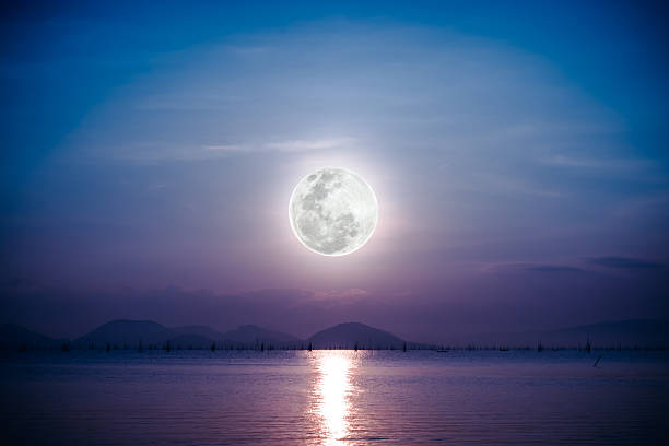 romantic scenic with full moon on sea to night. - romantic moon stock photos and pictures