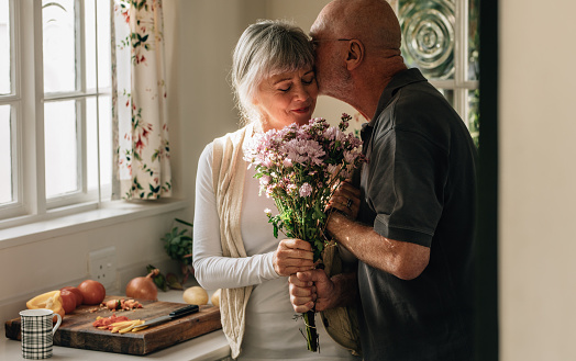 istock Romantic senior couple at home expressing their love 1064683172