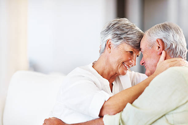 Romantic senior couple at home stock photo