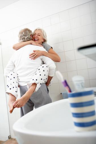 Romantic Senior Couple In Bathroom Stock Photo - Download ...
