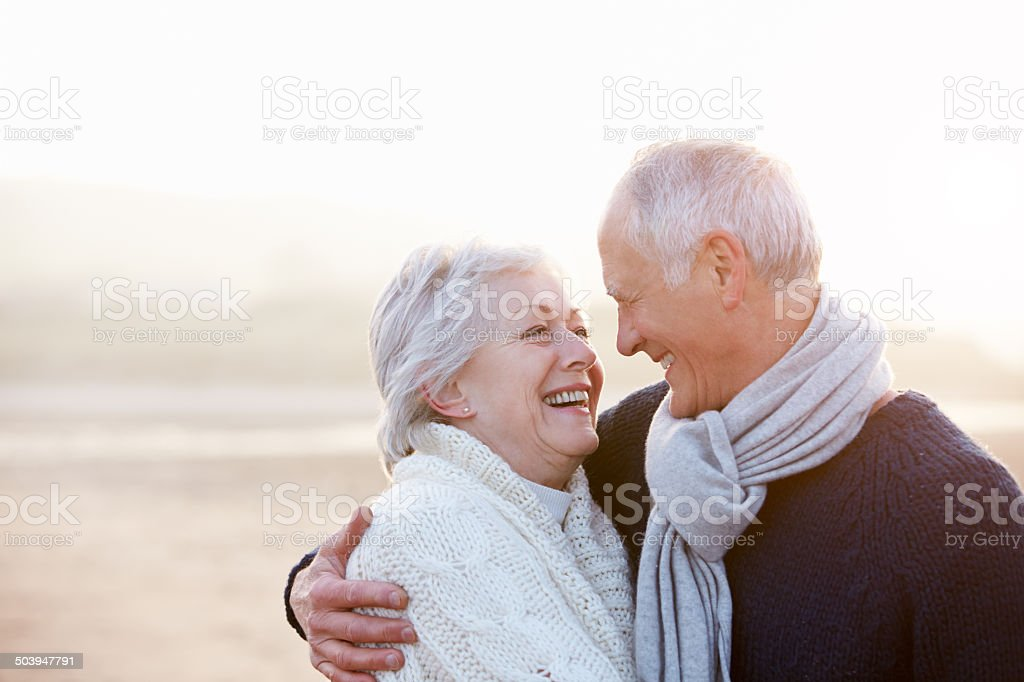 Romantic Senior Couple On Winter Beach stock photo