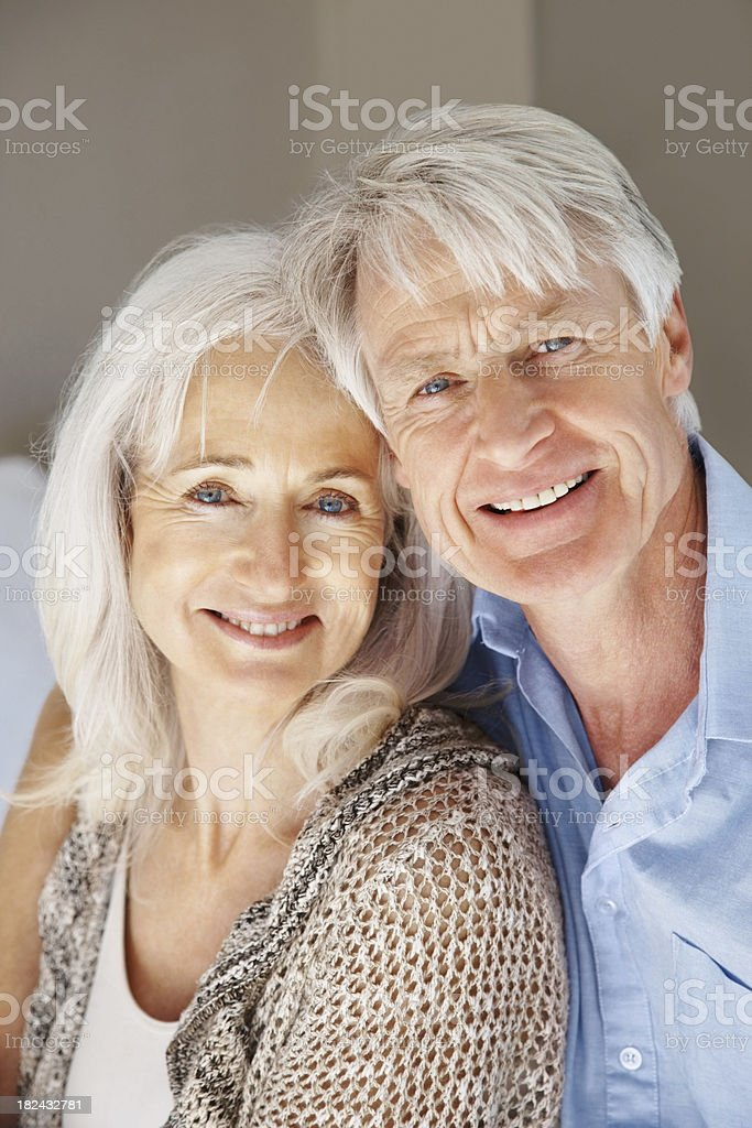 Romantic senior couple smiling together at home royalty-free stock photo