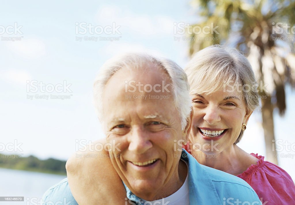 Romantic senior couple smiling together royalty-free stock photo